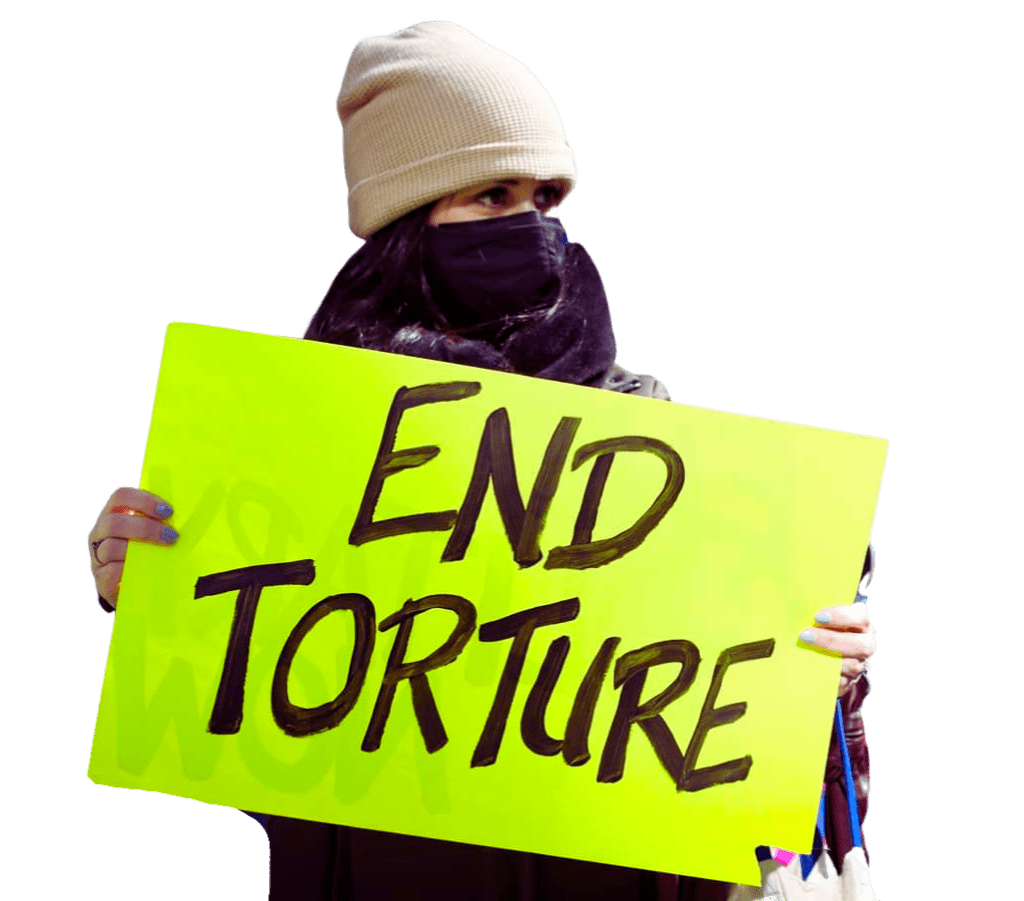 """Protestor holding """"End Torture"""" sign"""